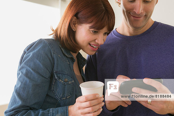 Close up of couple looking at mobile phone