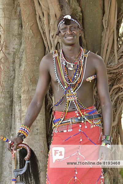 Maasai warrior wearing traditional dress