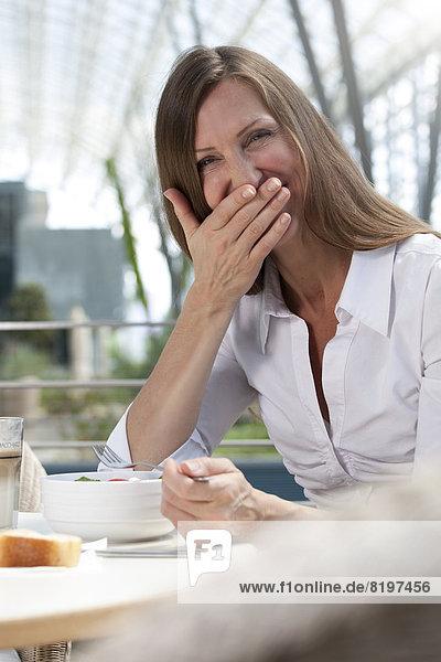 Businesswoman having lunch break