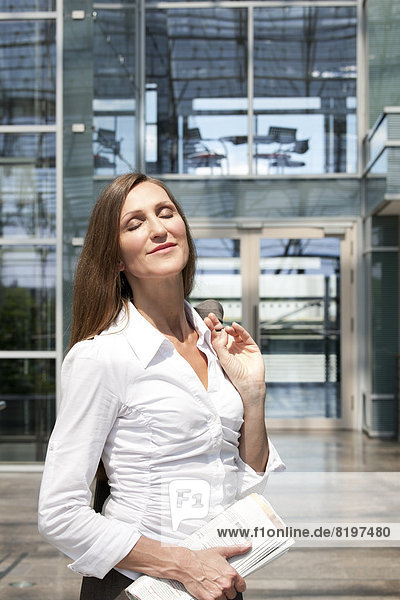 Businesswoman in front of office building