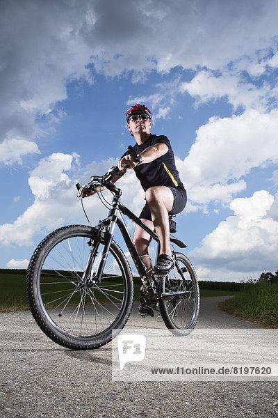 Mature man riding mountain bike