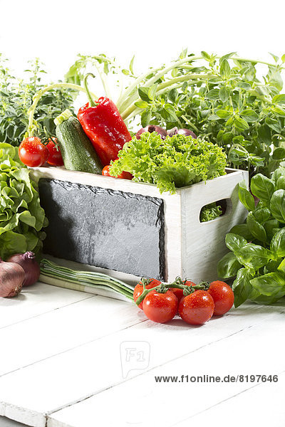 Variety of fresh vegetables in wooden box  close up