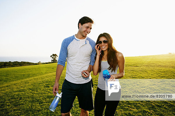 Couple walking together in park