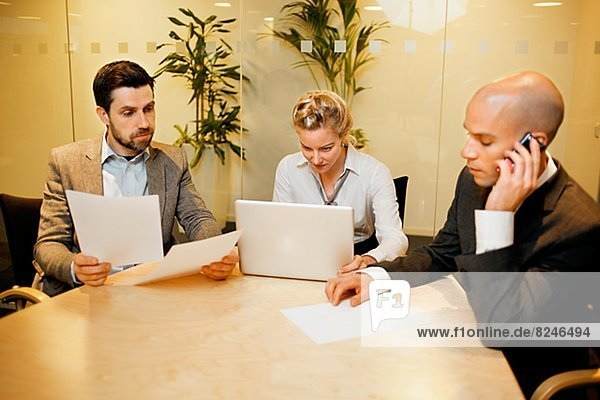 Business meeting  people sitting at conference table