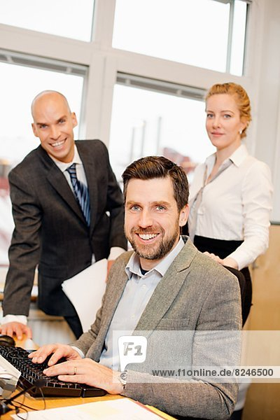 Three business people in office  portrait