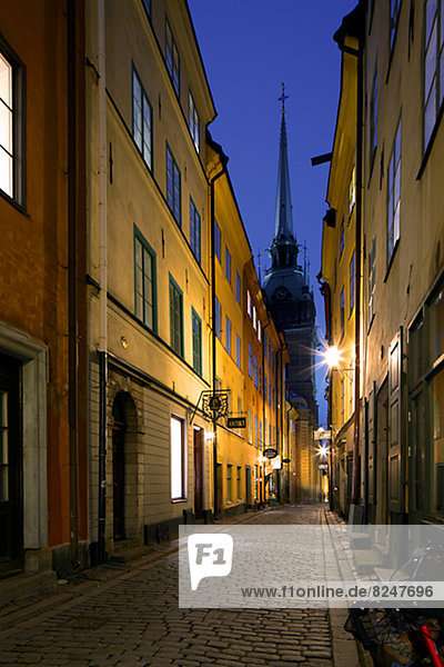 Illuminated alley at old town in Stockholm