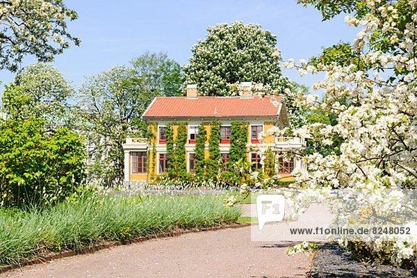 Garden at spring  house in background