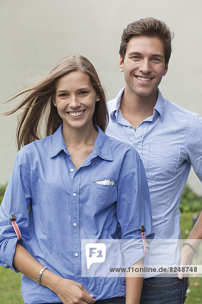 Germany  North Rhine Westphalia  Duesseldorf  Portrait of young man and young woman  smiling