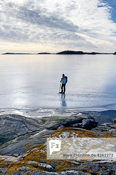 Mensch  Meer  gefroren