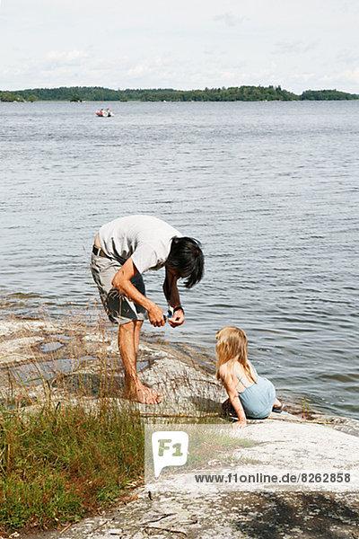 unterrichten Menschlicher Vater See angeln Tochter