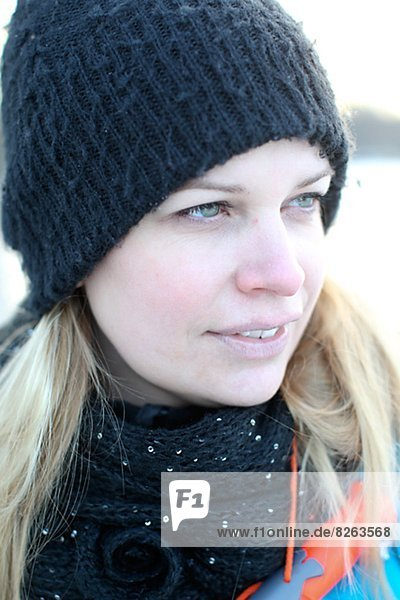Woman wearing knit hat looking away