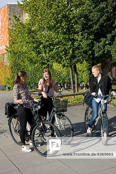lächeln  radfahren  Student  Universität