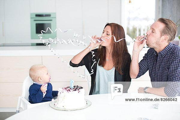 Parents celebrating with son his first birthday