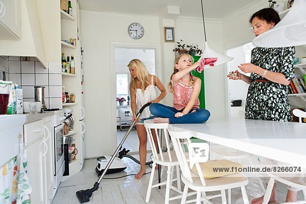 Mother with daughters tidy up