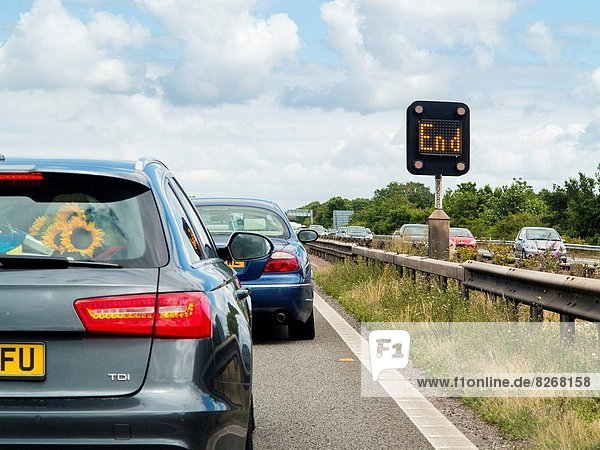 Motorway queues and lit END sign showing end of problem  M5  England.