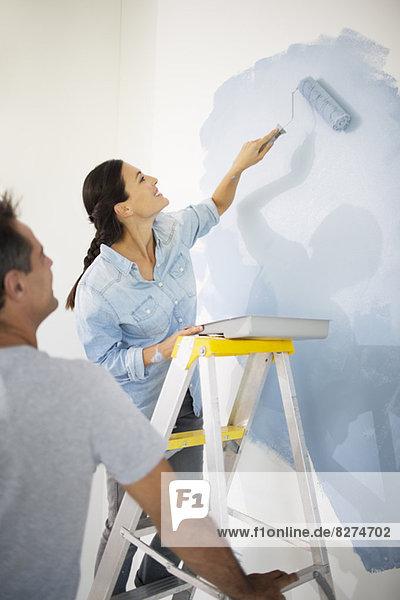 Paar Malerei Wand blau