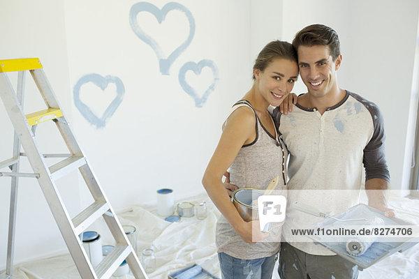 Paar Malerei blaue Herzen an der Wand