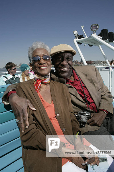 Mature couple sitting on a ferryboat