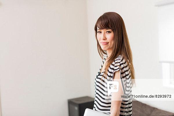 Portrait of woman wearing striped top