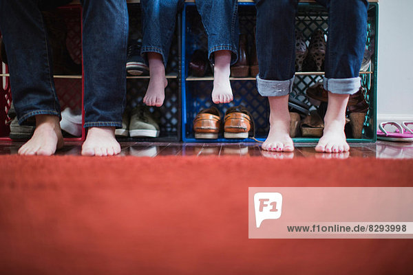 Child and parents with bare feet  low section