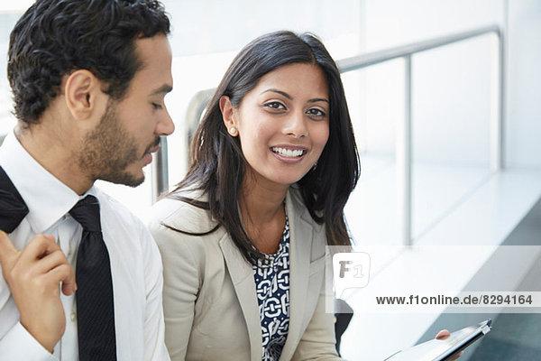 Businesspeople using digital tablet