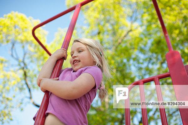 Girl on climbing frame