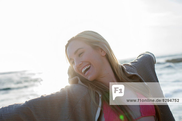 Woman flinging arms wide open in happiness