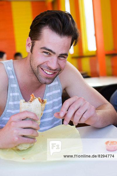 Man enjoying Lebanese bread wrap