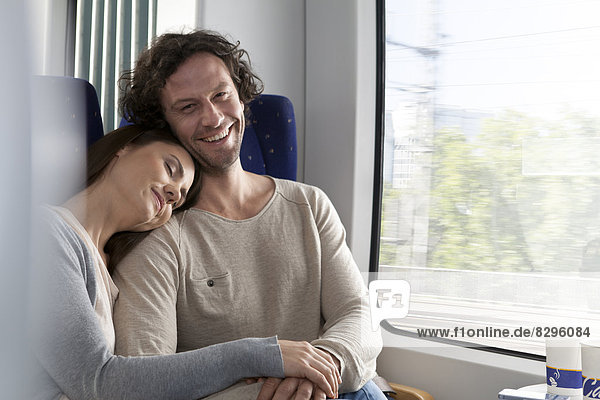 Relaxed couple in a train
