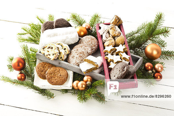 Christmas cookies,  Christmas stollen and ginger bread in wooden boxes,  studio shot in wooden boxes,  studio shot