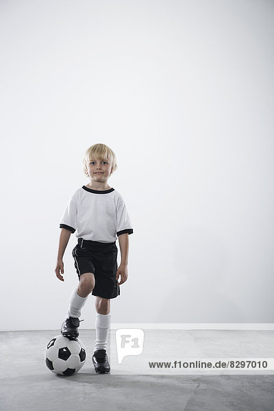 Boy in soccer jersey with ball