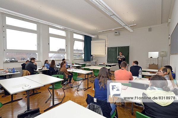 Young trainee teacher teaching a class  classroom