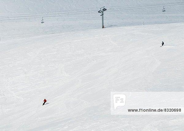 Canada  BC Sun Peaks. Skiers on the Crystal Bowl ski run  at Sun Peaks Ski Resort.