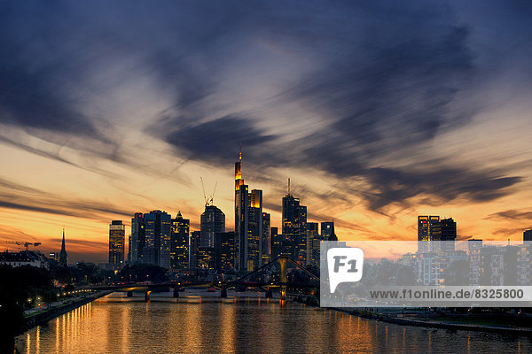 Skyline of Frankfurt with the Main River at dusk