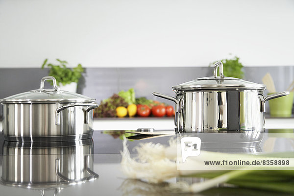 Germany    Pot and vegetables on kitchen surface