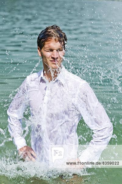 Germany  Bavaria  Tegernsee  Wet groom in lake