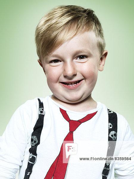 Portrait of smiling little boy  studio shot
