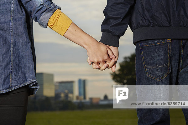 Germany  Dusseldorf  Young couple holding hands
