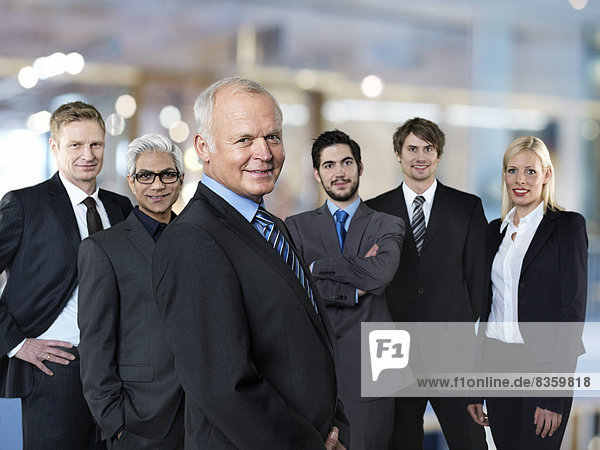 Group of six successful business partners