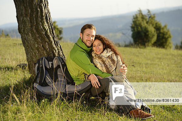 Smiling couple at a tree
