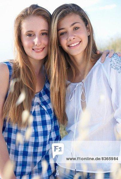 Portrait of two teenage girls  Tuscany  Italy