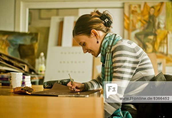 Young woman drawing picture