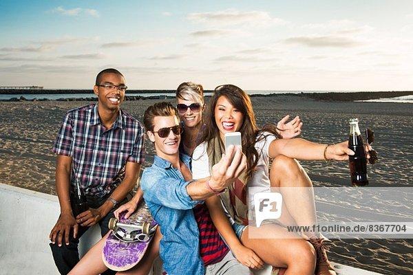 Friends photogrpahing themselves  Mission Beach  San Diego  California  USA