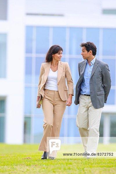 Businessman and businesswoman walking in business center. San Sebastian Technology Park. Donostia. Gipuzkoa. Basque Country. Spain.