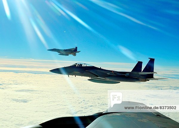 Two F-15C Eagles from the 48th Fighter Wing prepare to return to their simulated air combat portion of the Arctic Challenge exercise Sept. 20  2013  over Norway. Six nations participated in the exercise to boost interoperability between NATO  the U.S.  th