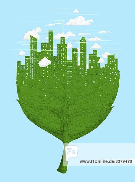 Skyline einer Stadt auf grünem Blatt