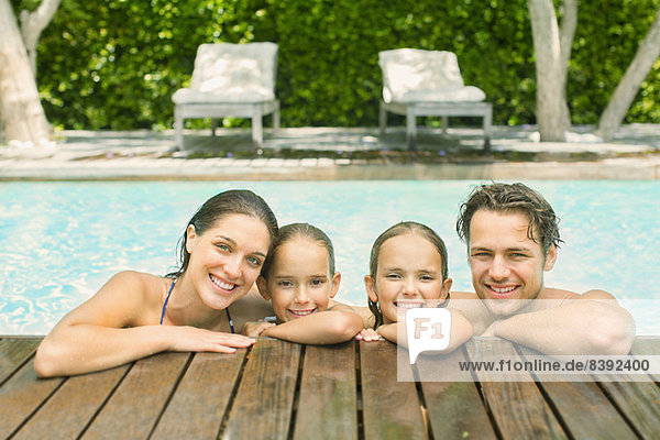 Family relaxing together in pool