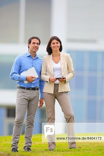 Businesswoman and businessman in business center. San Sebastian Technology Park. Donostia. Gipuzkoa. Basque Country. Spain.