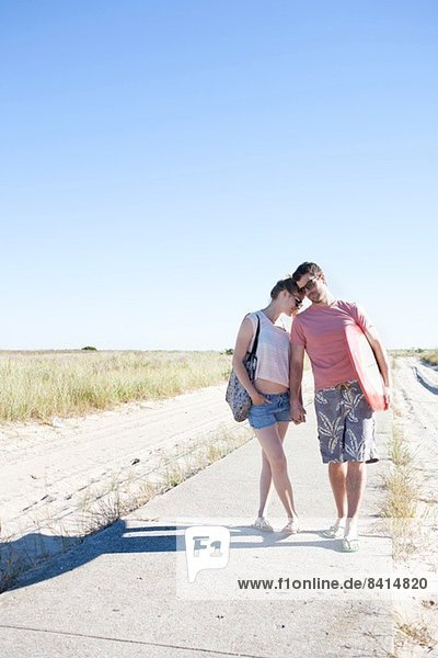 Couple on coastal path  Breezy Point  Queens  New York  USA