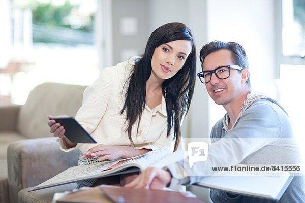 Interior designer and client looking at design books
